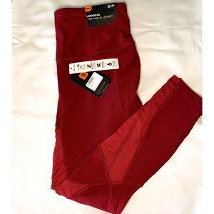 RBX Burgundy leggings w/mesh assents. Size small.